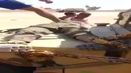 جيش حكومة العبادي الدمج وهم يمثلون بجثث القتله على الطريقة الفارسية